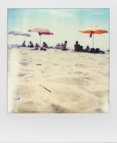 Sand, sky, umbrellas, sun. In one word: summer. | by ale2000