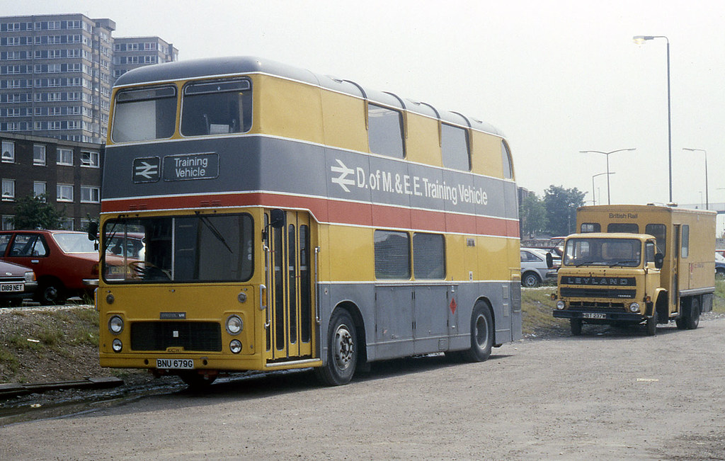 This Bristol VRT, registered BNU 679G, first entered in to service in 1969, operating in Midland General's fleet. In the 1980s, after a short spell working for Trent Motor Traction Company, it was sold to British Rail to be used as a mobile staff training vehicle by their Department of Mechanical & Electrical Engineering, based at the Railway Technical Centre, London Road, Derby. Once in non-passenger service BNU 679G was given a makeover and repainted in the unique eye catching livery of British Rail. Many of its windows were removed and filled in and the bus seat interior was stripped out to make it more suited to a new role as an office space for staff training. Image Source John Law on Flickr