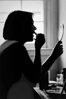 Silhouette of a Woman applying lipstick at Vanity | by floralgal
