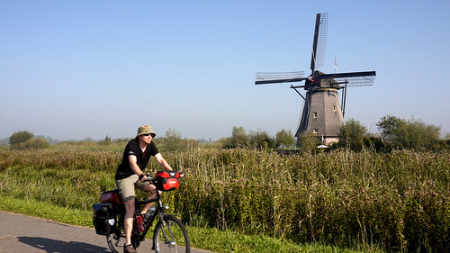 Cycling past the windmills of Kinderdijk | by travelling two