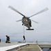 U.S. Navy SEALs conduct fast roping from an HH-60H Sea Hawk helicopter onto a gas and oil platform