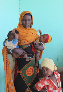 Mom with her children who are recovering from malnutrition at a health clinic in southern Ethiopia