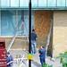 Workmen boarding up Haverstock School
