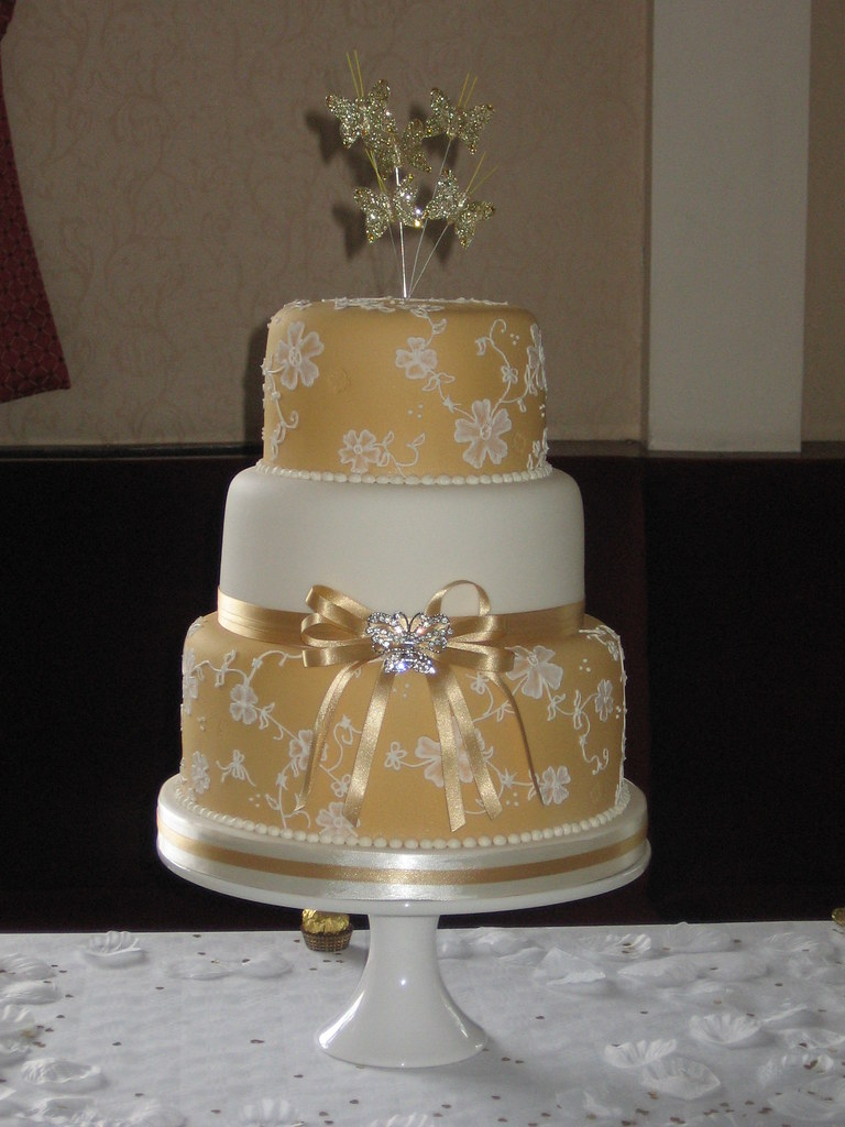 Gold and butterflies 3 tier wedding cake with brush embroi…   Flickr