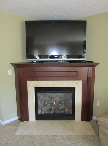 Corner Cabinet Fireplace W TV Above A Crema Marfil