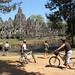 Cyclists photographing the Bayon, Angkor Thom