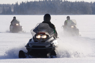 Snowmobiling across frozen lakes, Finland | by Exodus Travels - Reset your compass