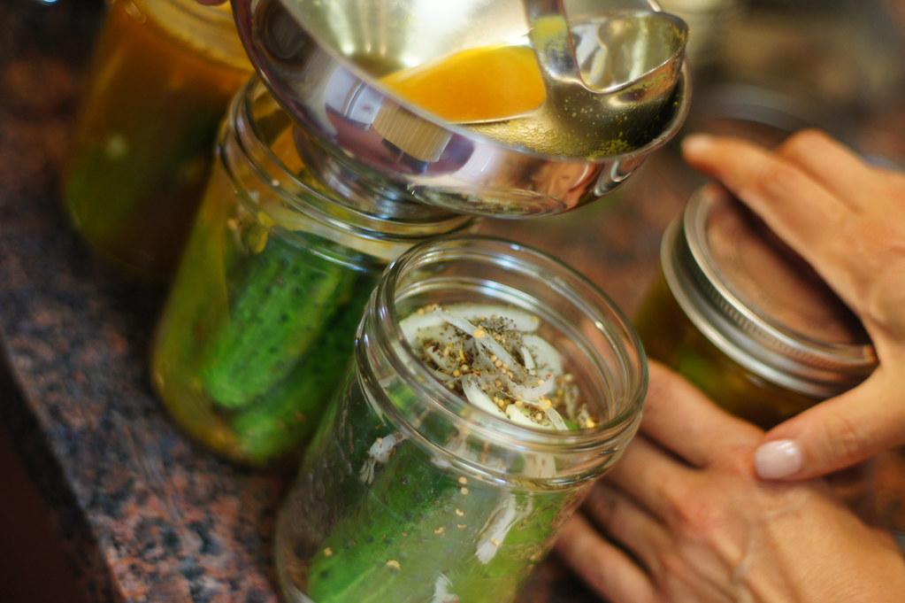 KEG pickle-making workshop   Pouring the pickling liquid int ...