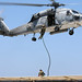 A U.S. Navy SEAL fast ropes from an HH-60H Sea Hawk helicopter