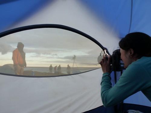 Ami shooting Richard thru tent | by Thelon River Expedition
