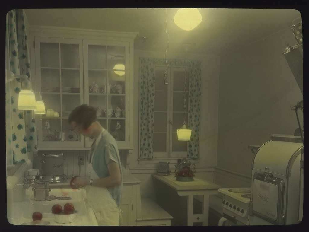kitchen 1930s. woman in kitchen circa 1930s by seattle municipal archives