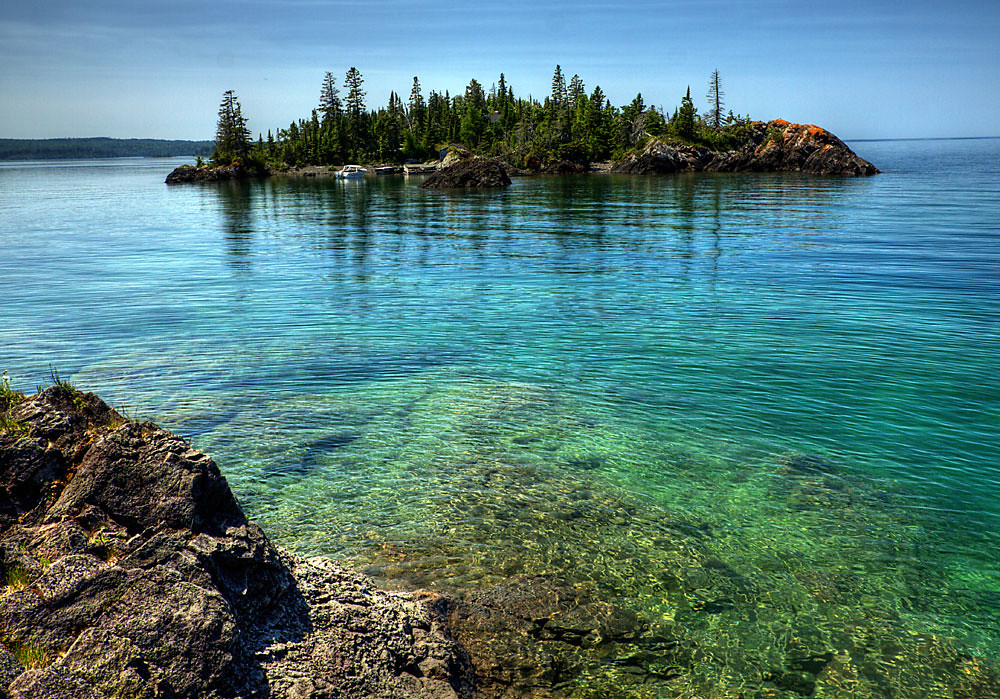 isle royale Michigan's isle royale national park is one of the least visited national parks, and the most revisited formed by the world's largest lava flow and sculpted by glaciers for millennia, the island rises from the depths of lake superior (which might as well be an ocean when you look at its size and behavior) and is accessible.