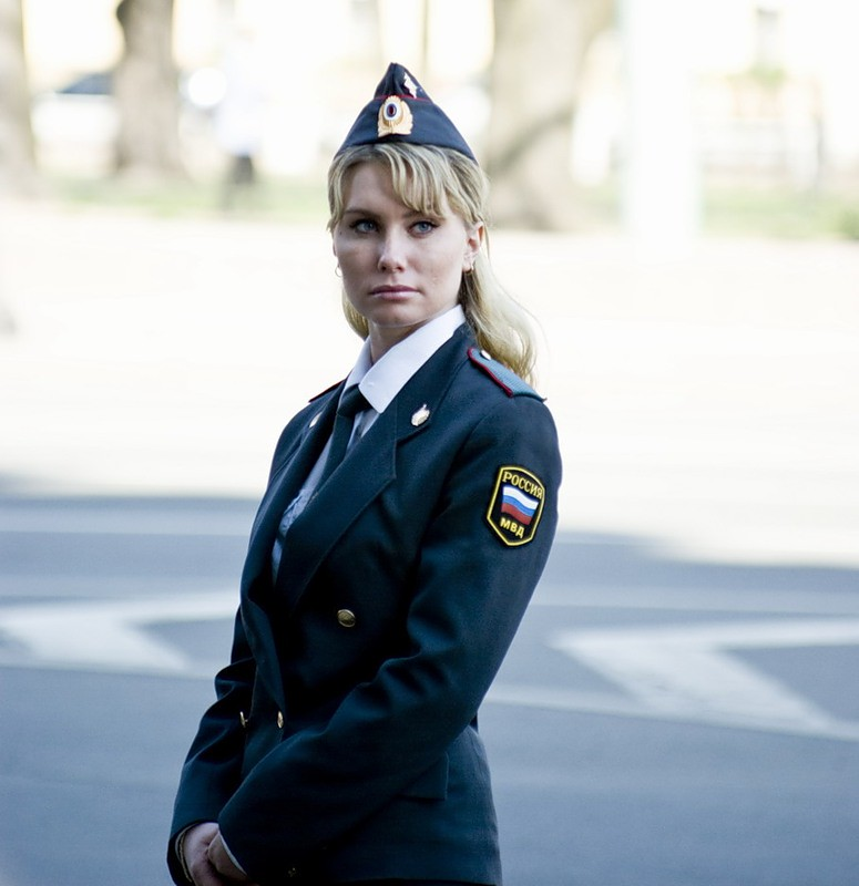 image Blonde white female police officer with black man