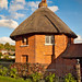 'The Round House', a quaint 19th Century octagonal thatched lodge at Stoke in Hampshire