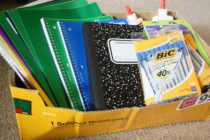 photo of back to school supplies like notebooks, pens and paper