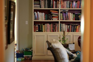 my cluttered bookshelves | by artsy-crafty babe