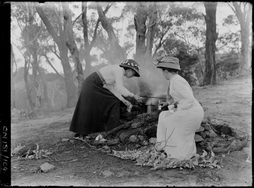 [Two women by the billy over a fire in bushland area], by Rex Hazlewood, c. 1909-1929 | by State Library of New South Wales collection