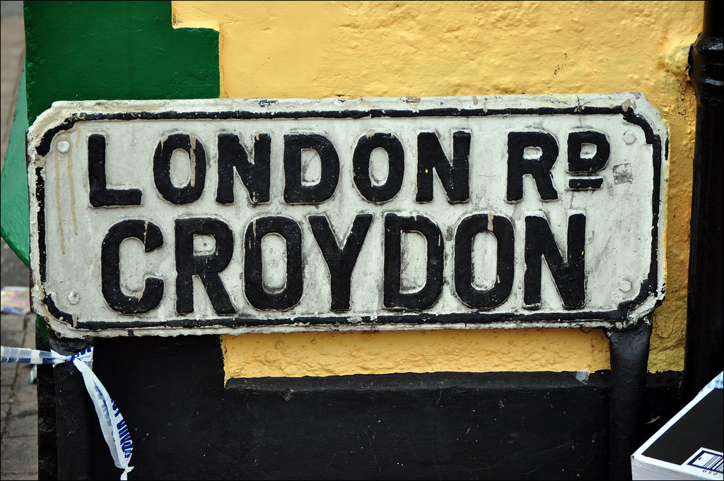 london rd croydon london road sign with police incident