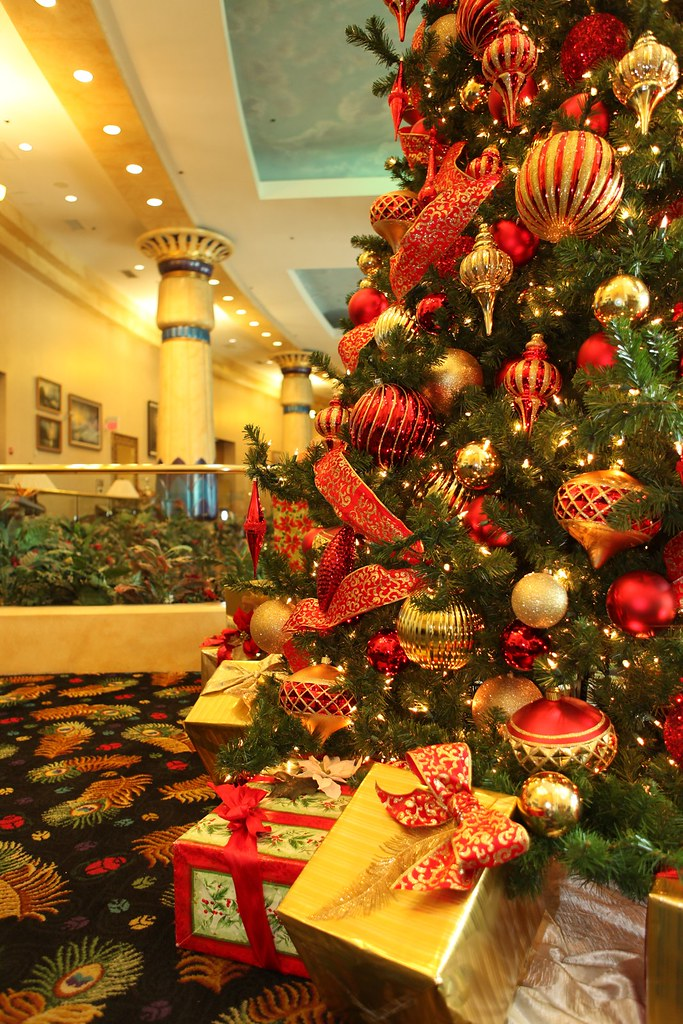 red and gold tree decorations by christmas specialists