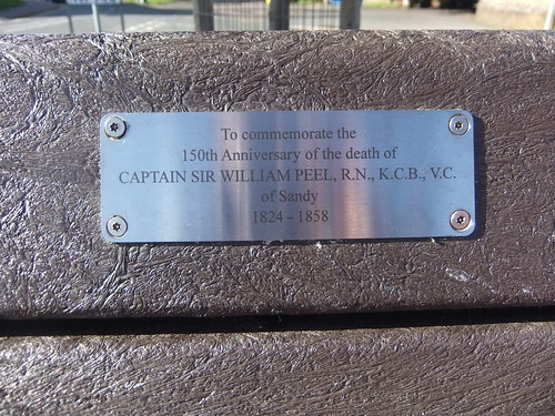 Plaque commemorating Captain Sir William Peel on a bench on the High Street, Sandy, Bedfordshire | by orangeaurochs