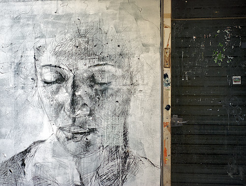 scratch-art in whitewashed shop window | by ollily