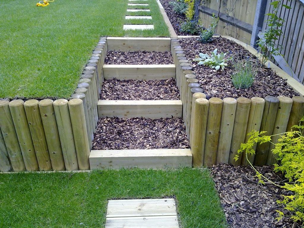 Terracing a sloping garden these photos show the for How to landscape a garden