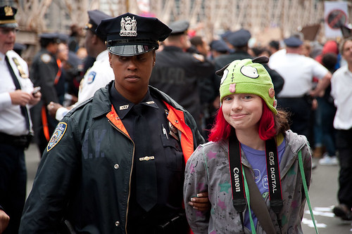 Girl in Green Hat Arrested: Occupy Wall Street Occupies the Brooklyn Bridge | by Adrian Kinloch