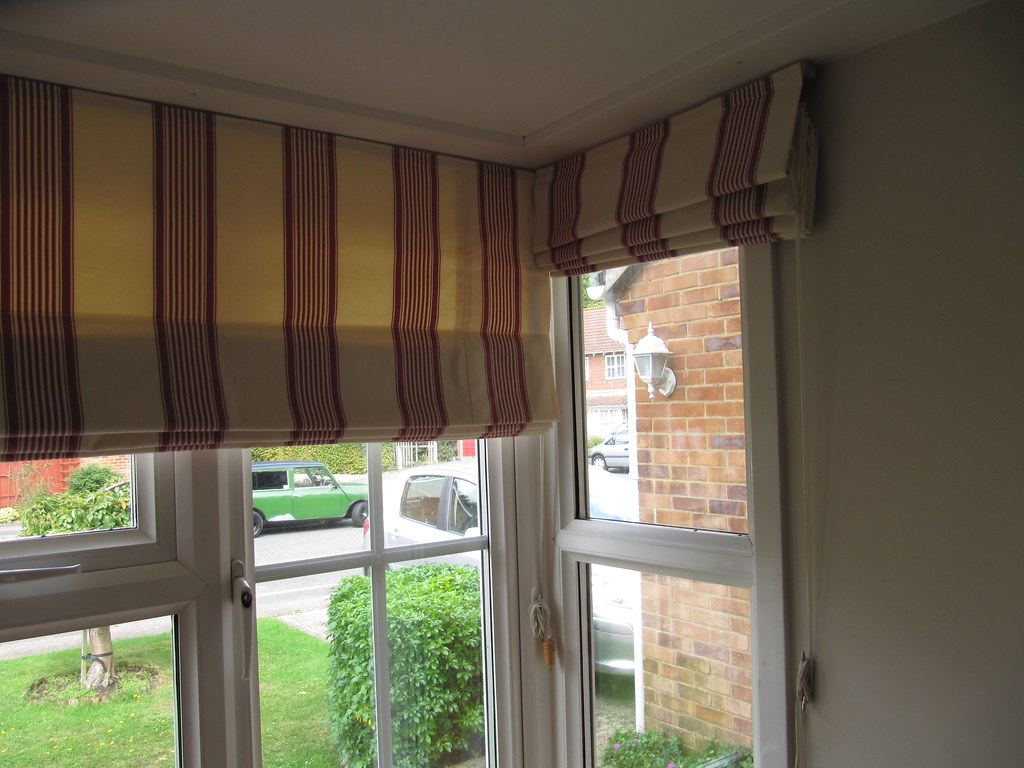 Roman blinds in a bay window striped roman blinds using for Roman shades for bay windows
