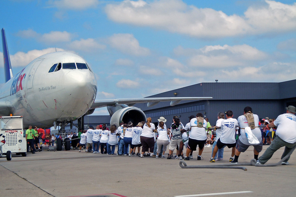 People pulling a jetplane