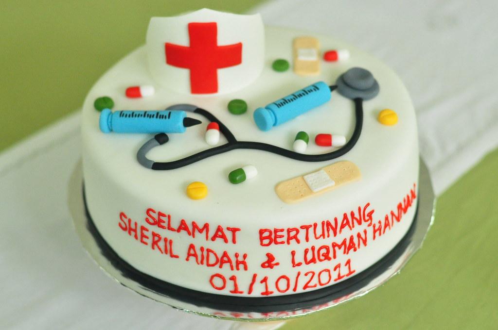Cake Decorating Nurses Theme : Nurse themed engagement cake Chocolate butter cake with ...