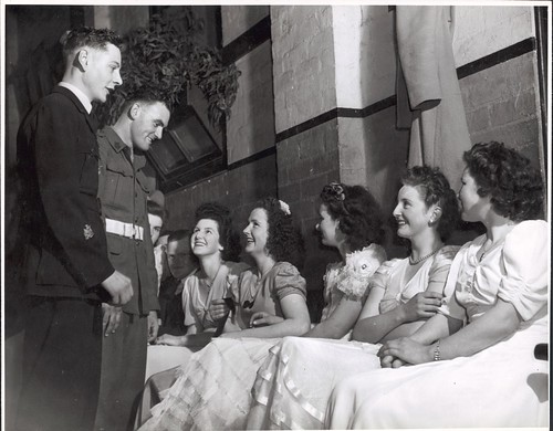 Wes Colquhoun and Fred Phair talking to the girls at the ball in the Soldier's Memorial Hall, Drouin, Victoria | by National Library of Australia Commons