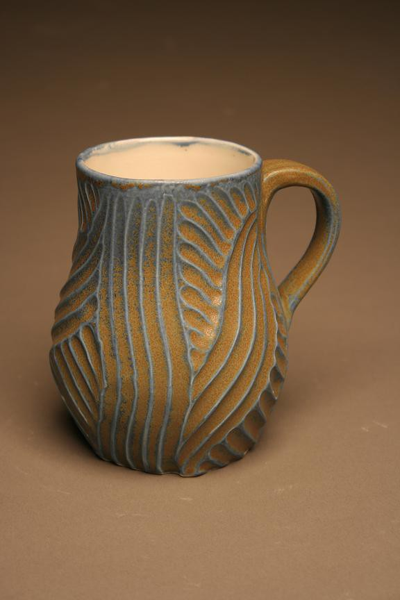 Blue and tan mug white stoneware thrown carved