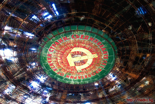 A proletarian motto and soviet symbol under the roof of an old bulgarian communist monument at Buzludzha | by Nedko