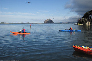 Leaving the Marina with Morro Rock in the background and the Morro Bay Museum of Natural History to the right. Kayakmorrobay Kayak and Standup Paddle Outing Sunday 25 September 2011, with Mike, Betty, Ann, Jovette, Kerry, and Joni | by mikebaird