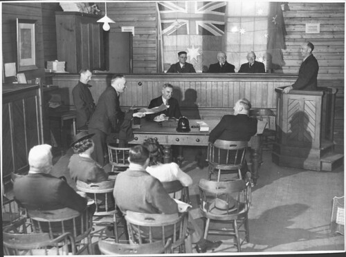 Justices of the Peace, Thomas Ryan, William Young and Frank Davis sit on the bench at the Drouin Courthouse,Victoria | by National Library of Australia Commons