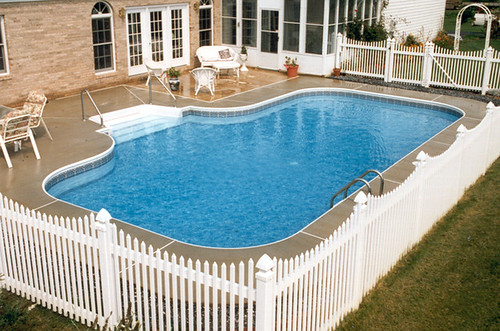 Inground swimming pool custom freeform concrete deck 01 for Custom inground swimming pools