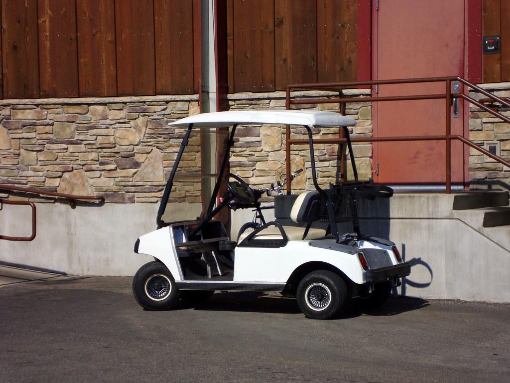 Golf cart beside knucklehead 39 s indoor amusement park flickr for Golf cart garage door prices