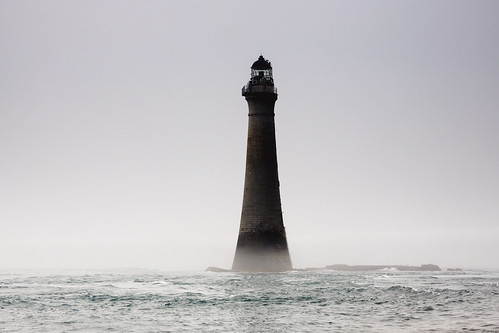Chicken Rock Lighthouse emerges from the fog, The Isle of Man | by iancowe