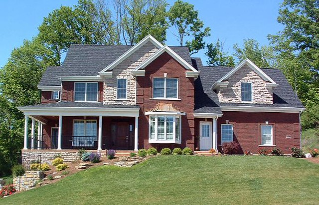brick home with decorative stone accents flickr photo