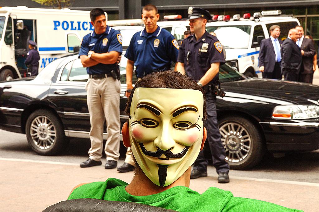 Guy-Fawkes-mask-and-three-policemen--Manhattan
