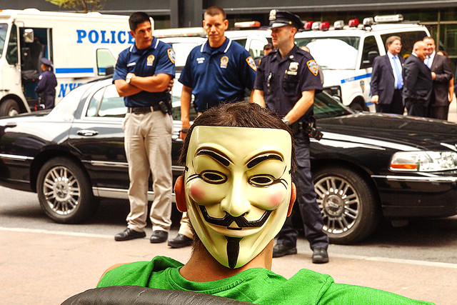 Guy-Fawkes-mask-and-three-policemen--Manhattan
