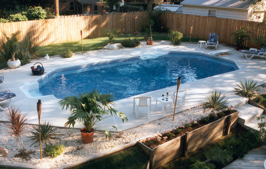 Inground swimming pool rectangle grecian concrete deck 03 for Grecian swimming pool