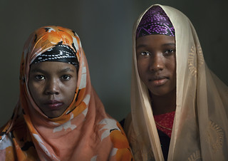 Couple Of Young Teenage Girls, Colorful Veils, Looking At Camera, Lamu, Kenya | by Eric Lafforgue