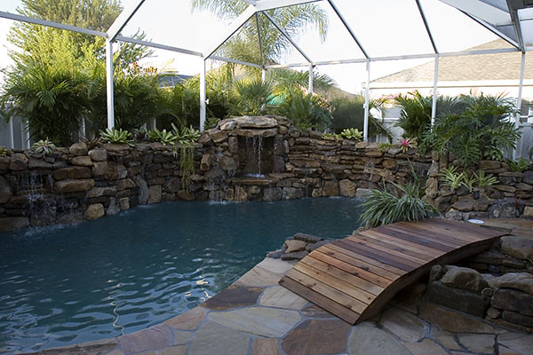Swimming pool remodel grotto stone waterfalls florida 8 for Swimming pool grotto design