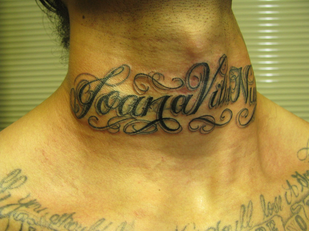 name on neck tattoo of a name in cursive on neck