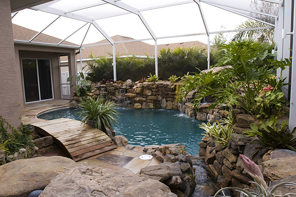 Swimming pool remodel grotto stone waterfalls florida 11 for Swimming pool grotto design