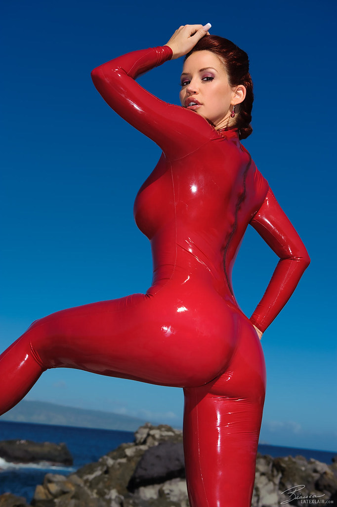 Bianca Beauchamp in very skintight red shiny latex catsuit
