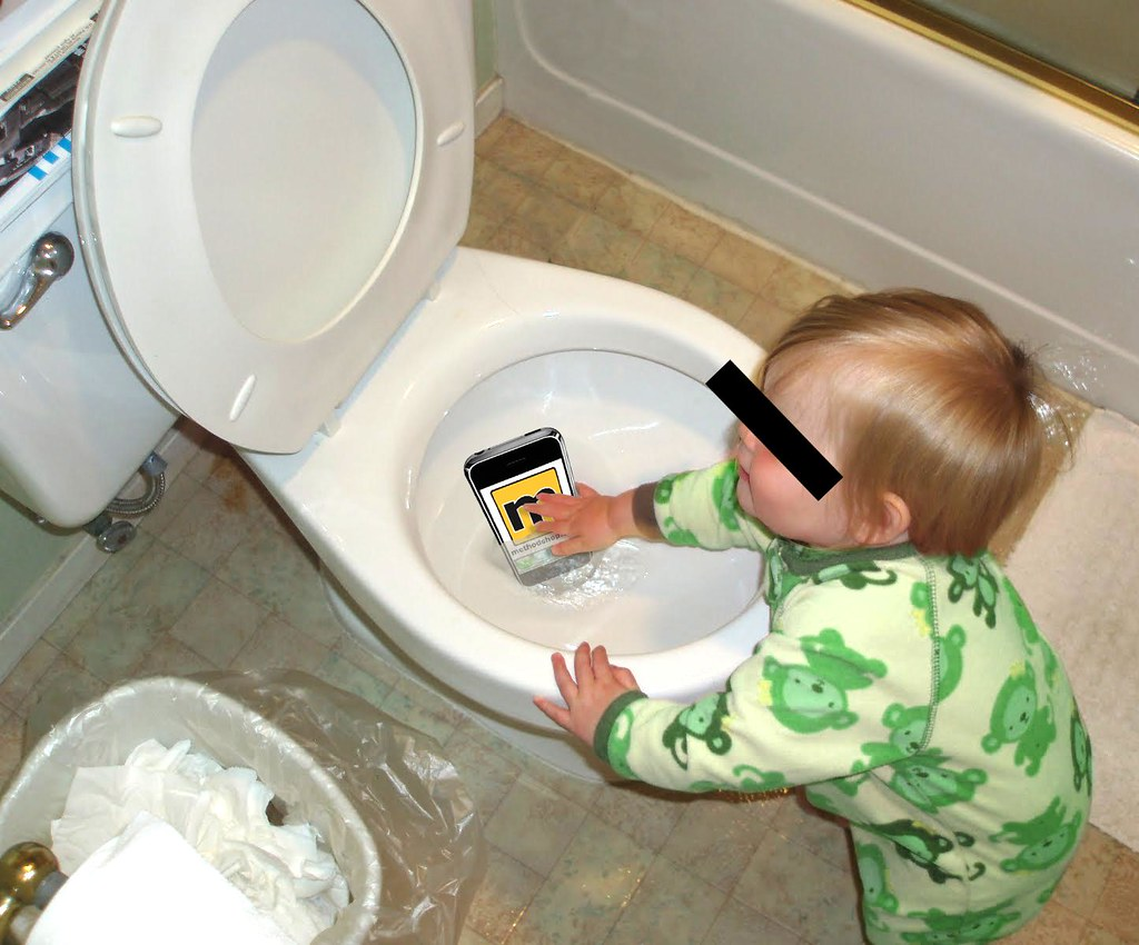 dropped iphone in toilet baby helps retrieve iphone from toilet omg if you are 14035