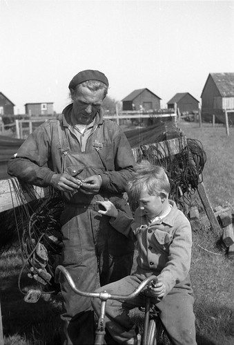 Fisherman and boy in Smygehuk, southernmost point of  Sweden, in 1954 | by Stockholm Transport Museum Commons
