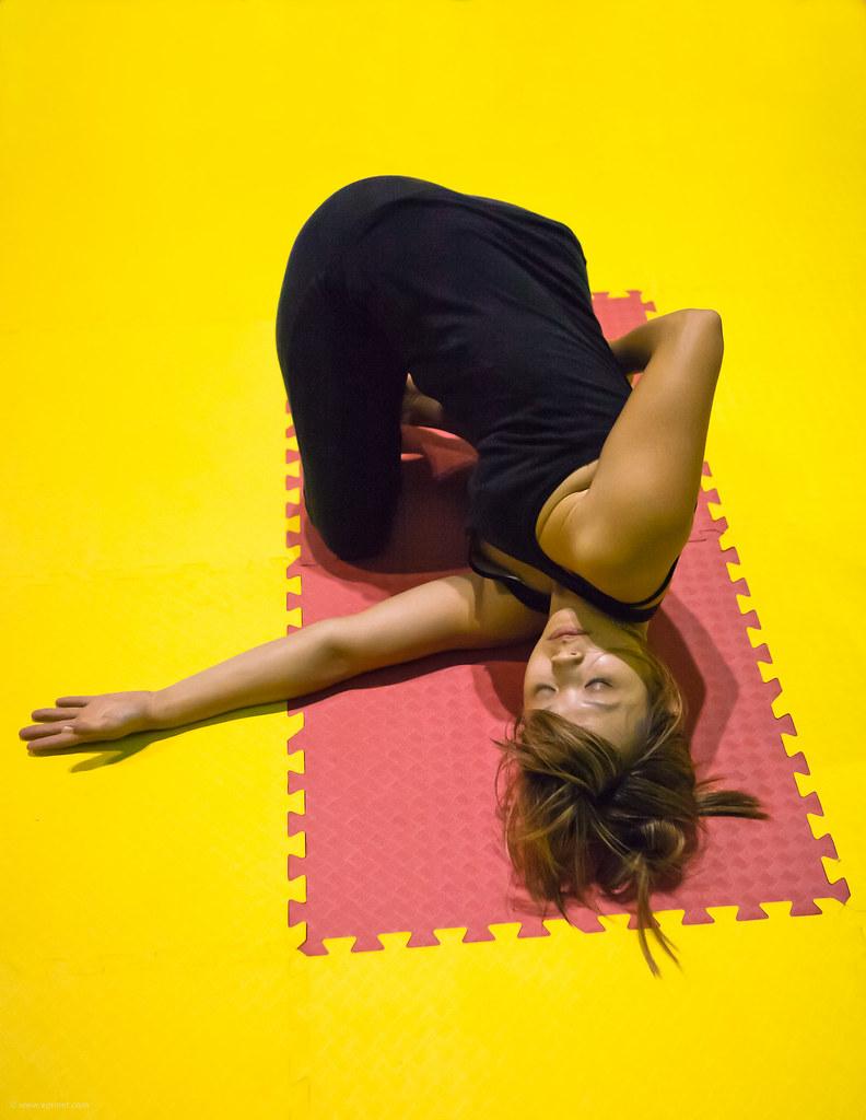 Yoga Jen Relaxing On A Yoga Mat Outside On A Nice Fall